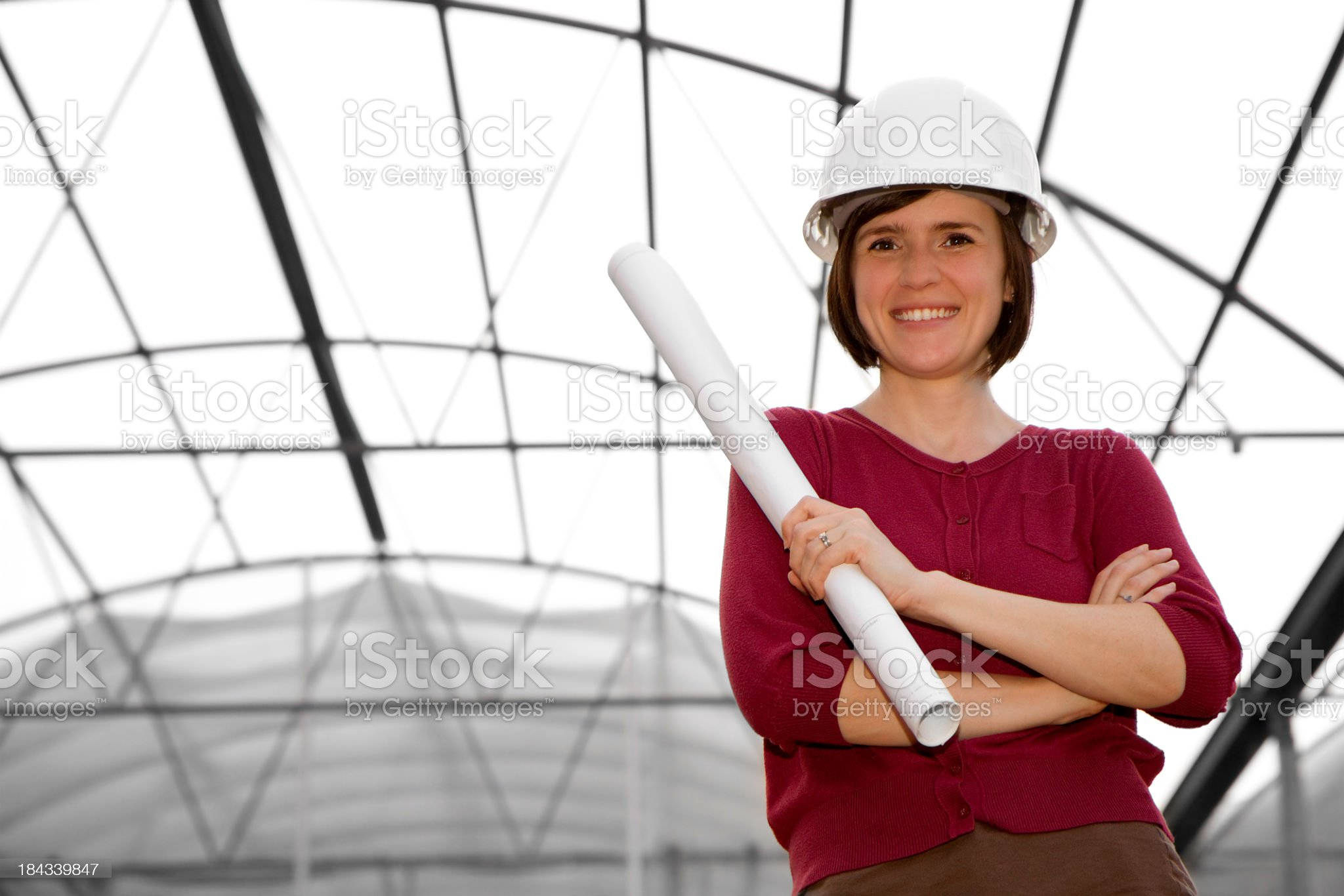 Construction Engineer with Blueprints (Greenhouse Background) royalty-free stock photo
