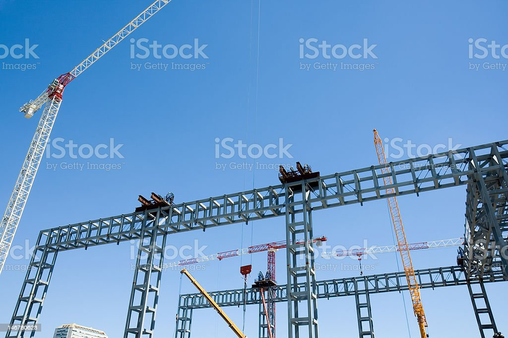construction engineering, cranes building with steel in blue sky royalty-free stock photo