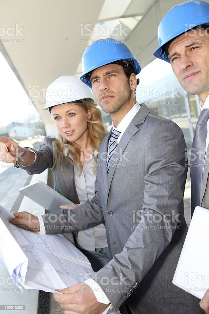 Construction engineers checking building site royalty-free stock photo