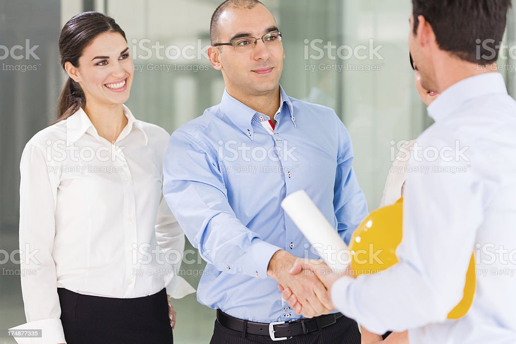 Construction engineers shaking hands royalty-free stock photo