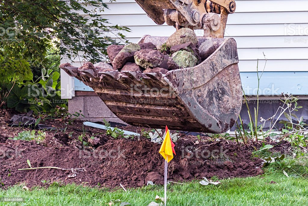 Construction Equipment Excavator Loaded With Rocks At Home Addition Project stock photo