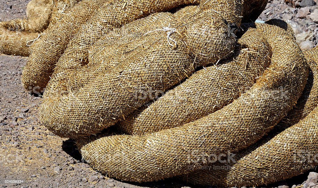 Construction erosion pollution control straw wattles closeup stock photo