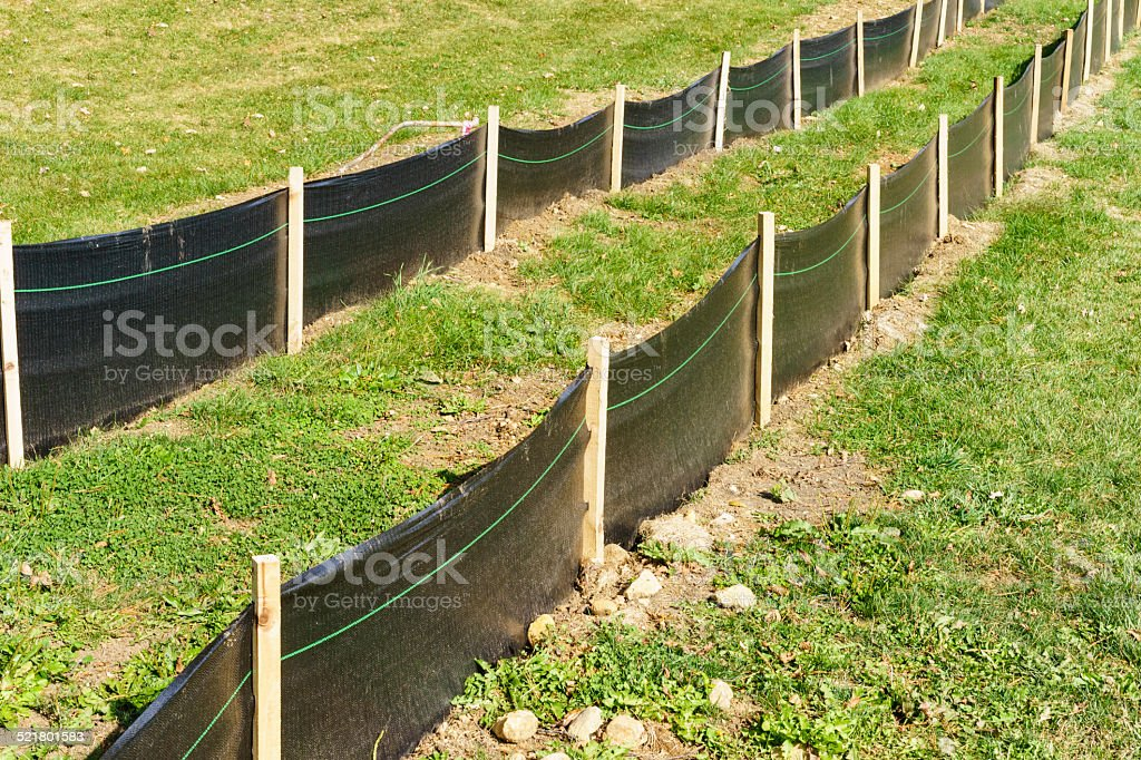 Construction fence of wood and plastic stock photo