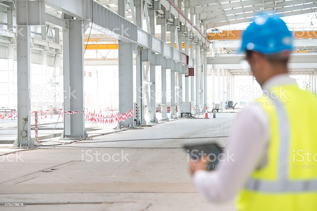 Construction Foreman Checking Progress stock photo