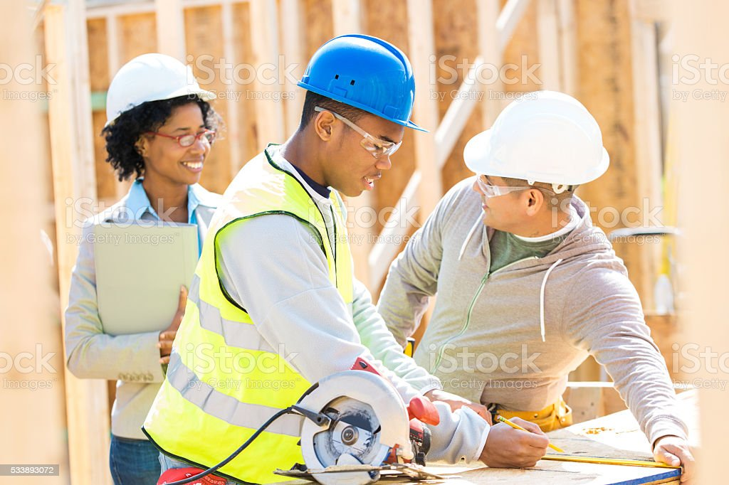 Construction foreman discuss project with home builder stock photo