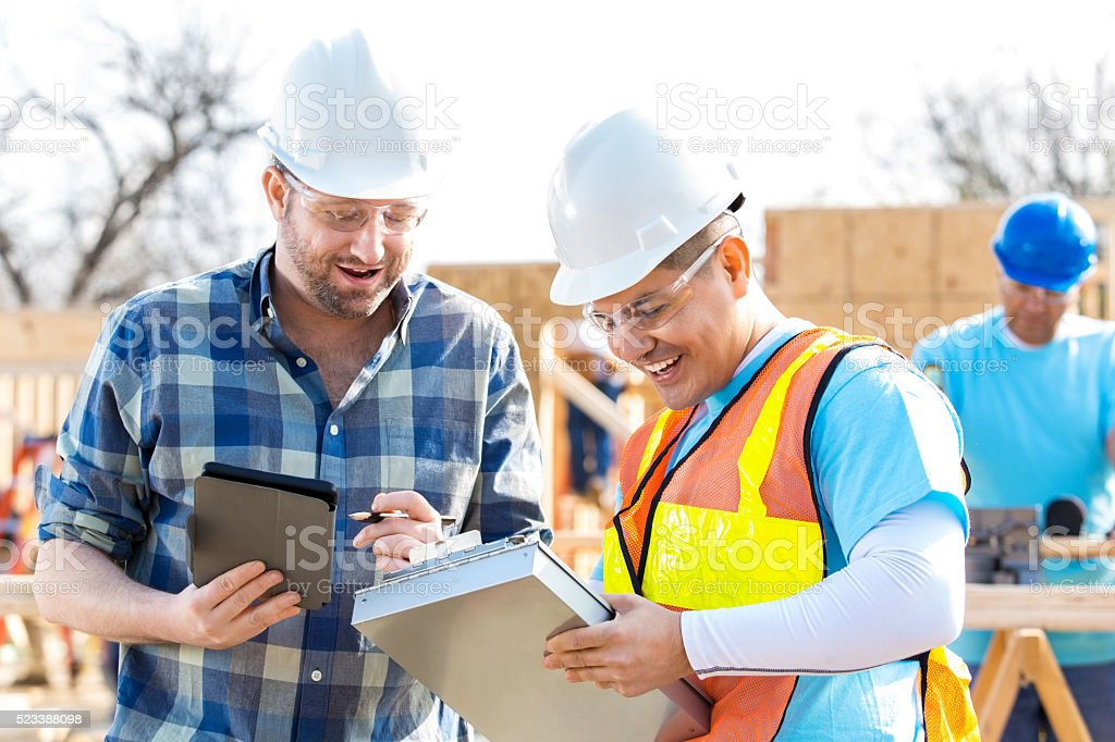 Construction foreman review project stock photo