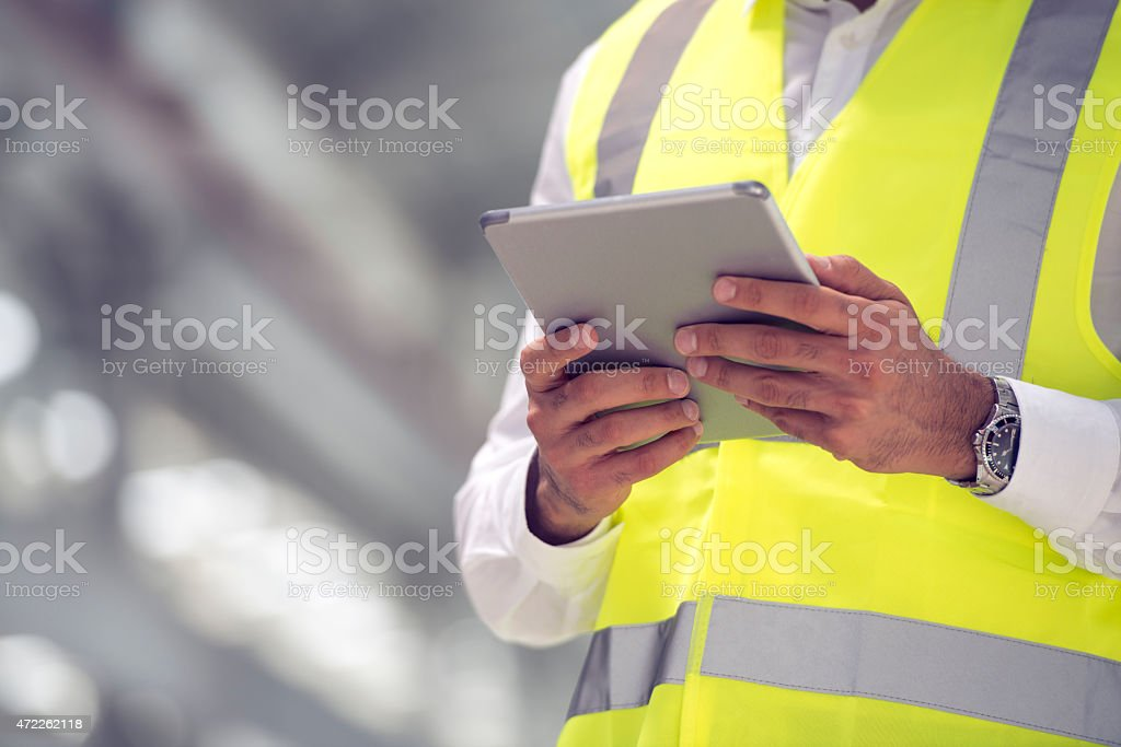 Construction foreman with tablet computer stock photo