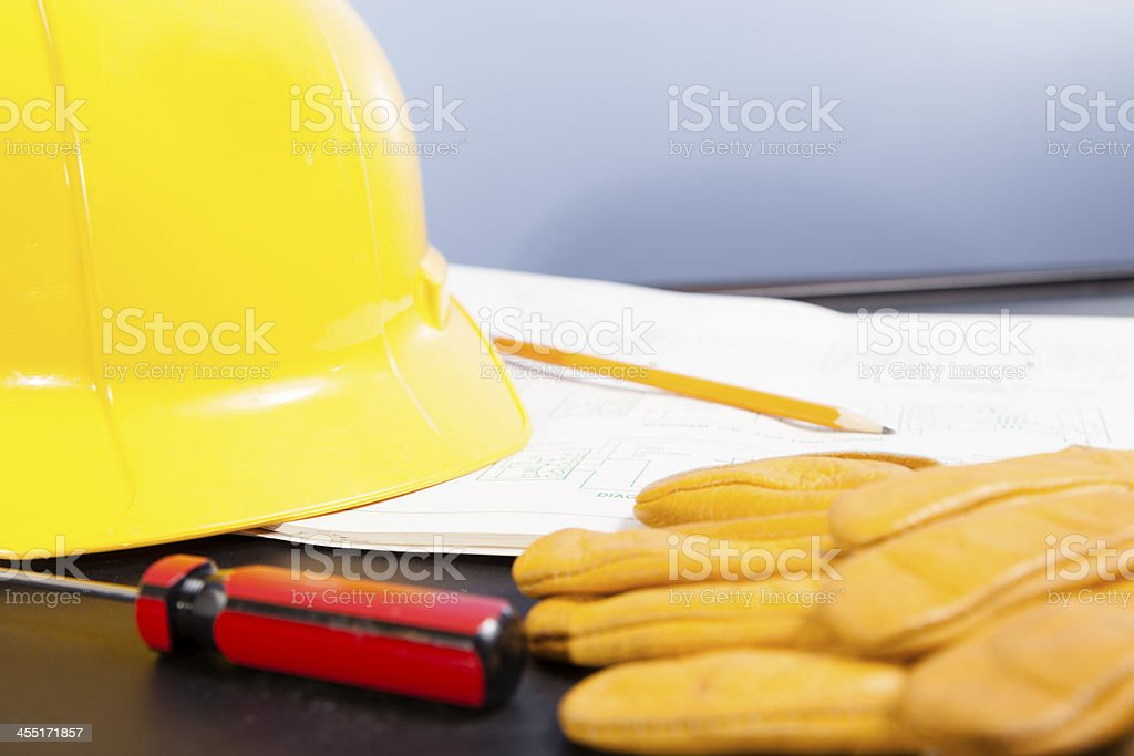 Construction: Hardhat and workman's tools on floorplans. royalty-free stock photo