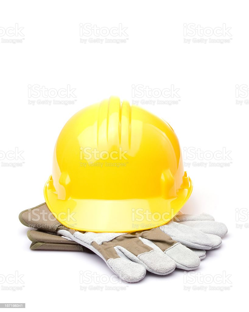 A construction hat sitting on gloves royalty-free stock photo