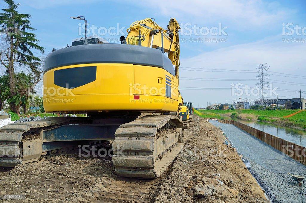Construction heavy equipment; caterpillar of excavator stock photo