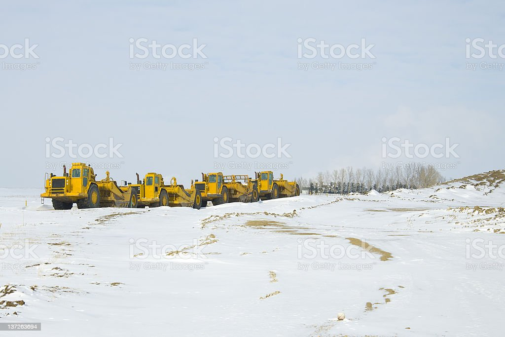 Construction Heavy Equipment parked in a Row royalty-free stock photo