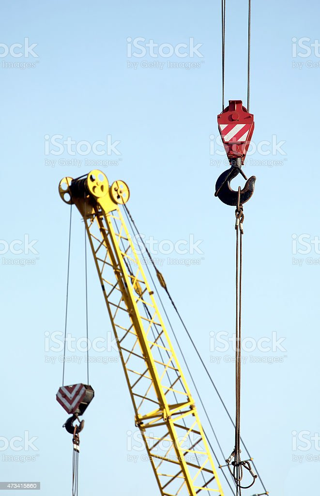 Construction hoisting tower cranes stock photo