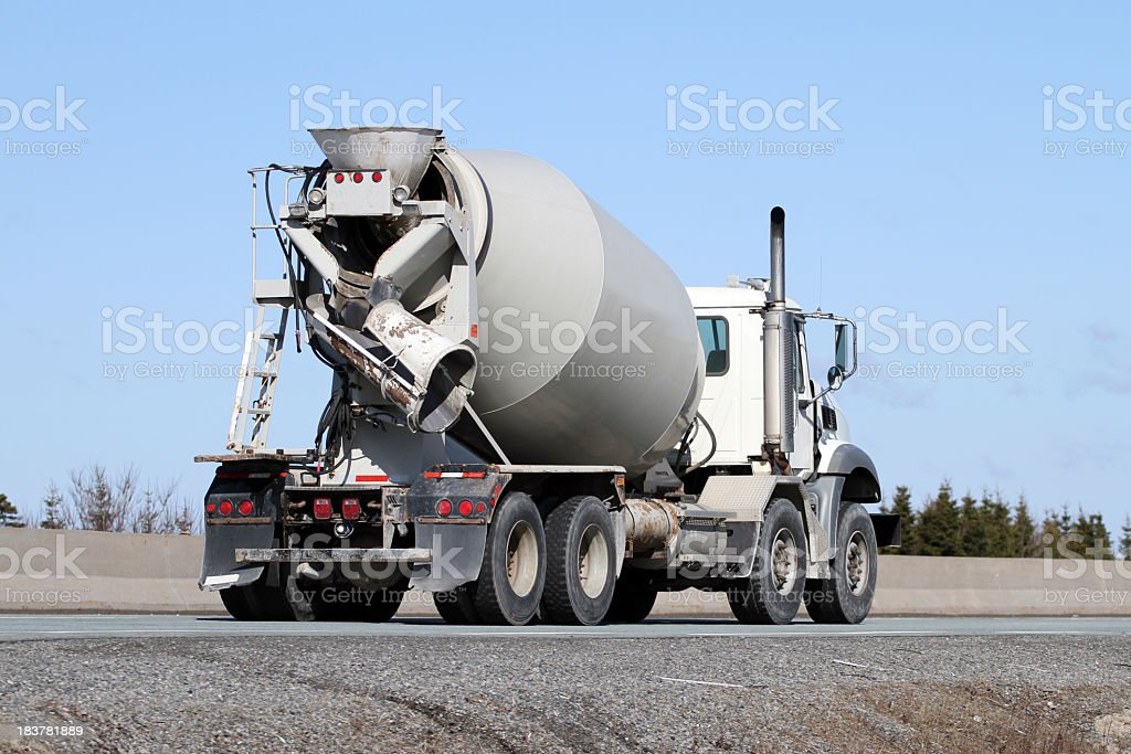 Construction Industry, Cement Truck Delivering A Load Of Concrete stock photo