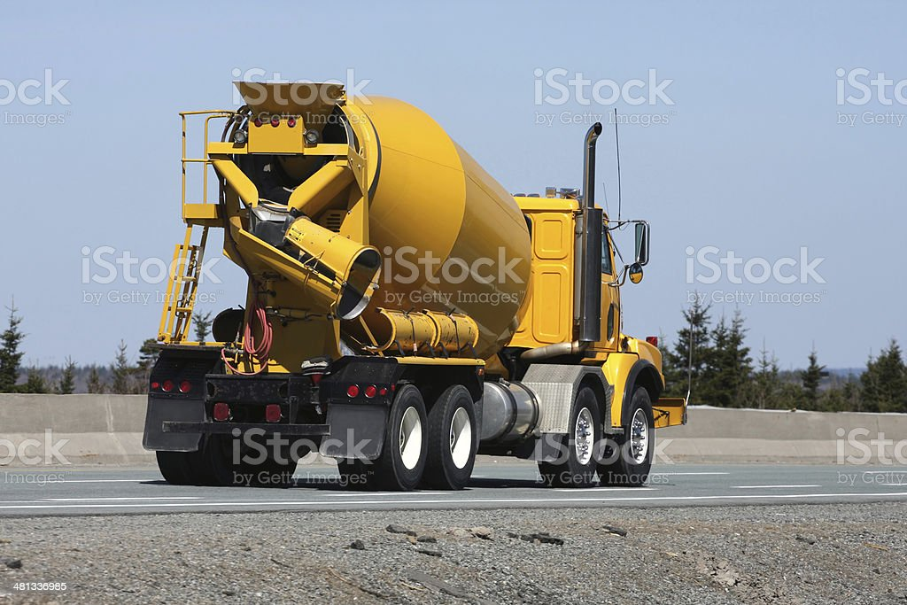 Construction Industry, Cement Truck Delivering Concrete To A Job Site stock photo