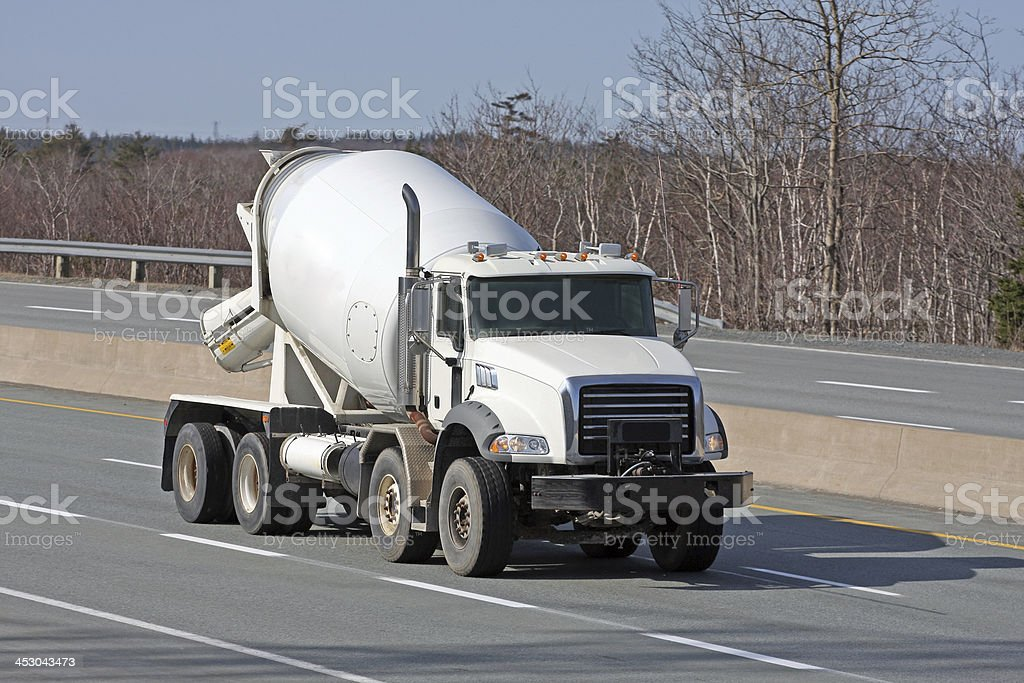 Construction Industry, Cement Truck Delivering Concrete To Job Site stock photo