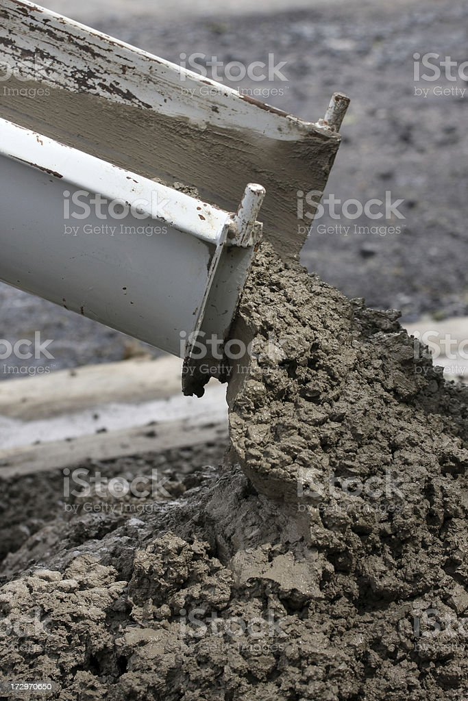 Construction Industry, Cement Truck Pouring Concrete At Job Site, Closeup royalty-free stock photo