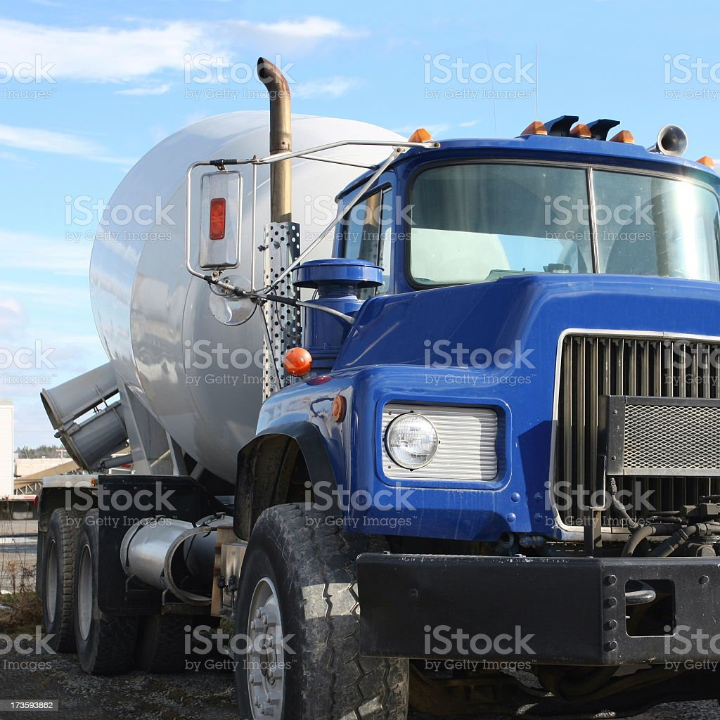 Construction Industry, Cement Truck Pouring Concrete At Job Site stock photo