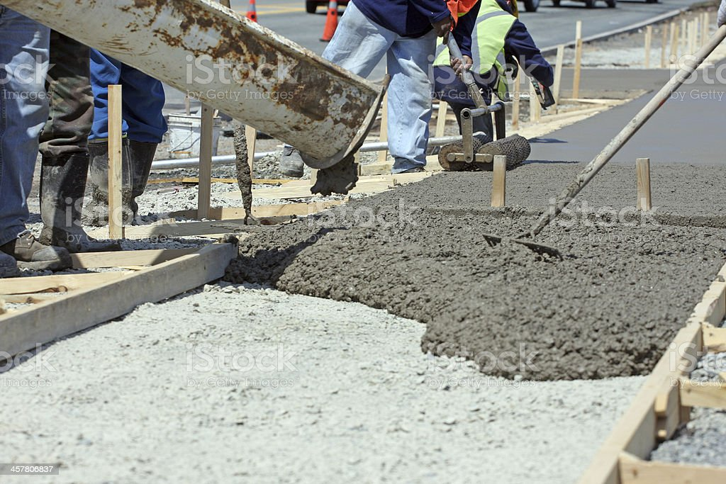 Construction Industry, Cement Truck Pouring Concrete For New Sidewalk stock photo