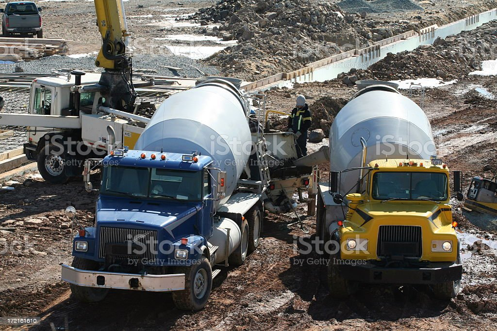 Construction Industry, Cement Trucks Delivering Concrete To  Job Site royalty-free stock photo