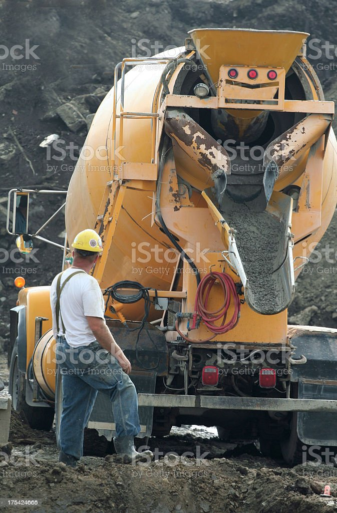 Construction Industry,Cement Truck Pouring Concrete At Job Site stock photo