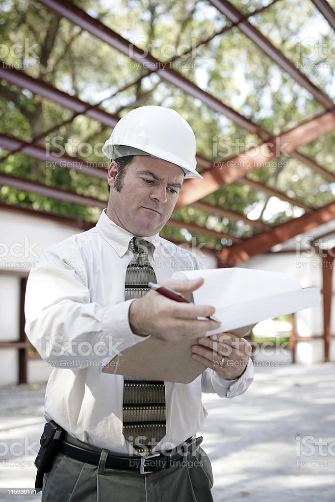 Construction Inspector - Reviewing Notes royalty-free stock photo