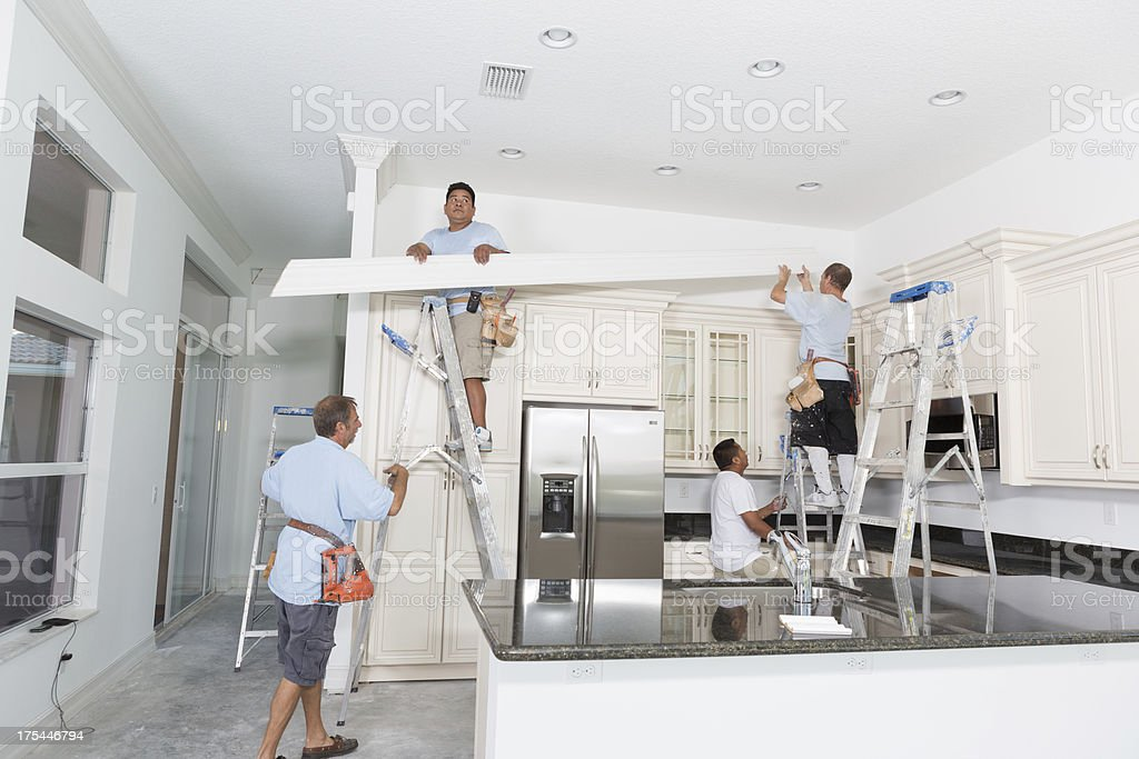Construction: Installing crown molding stock photo