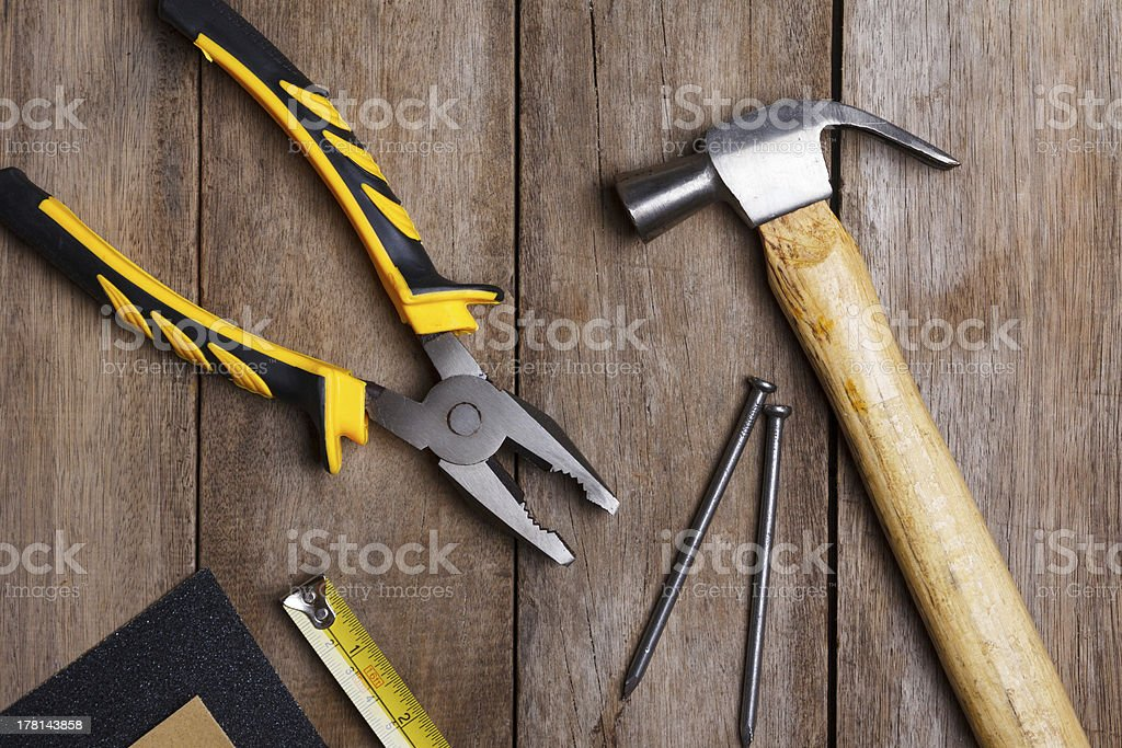 Construction instruments on wooden table royalty-free stock photo