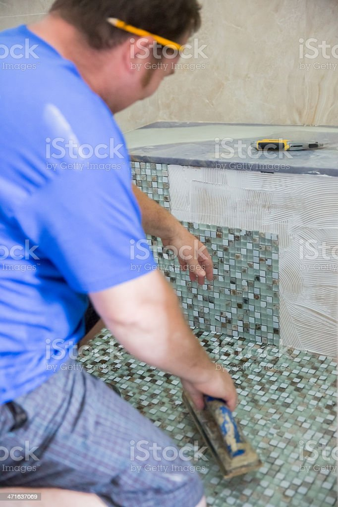 Construction: Laying a Glass tile Floor stock photo