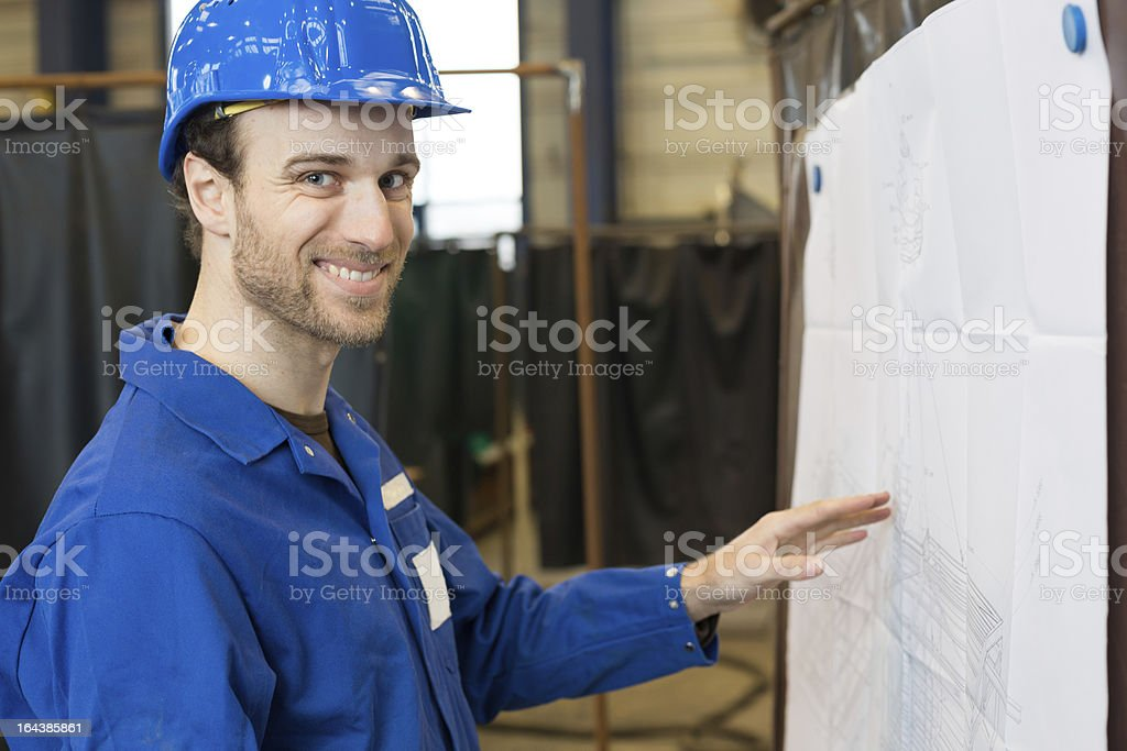 Construction looking at building plan royalty-free stock photo