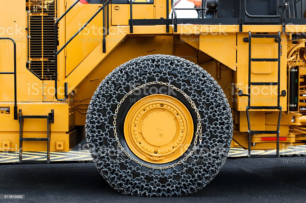 Construction Machinery with Chains on Tires stock photo