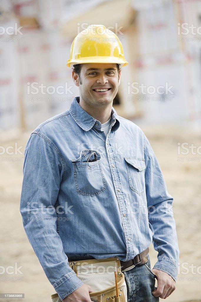 Construction Man Holding Blueprints Wearing Hard Hat royalty-free stock photo