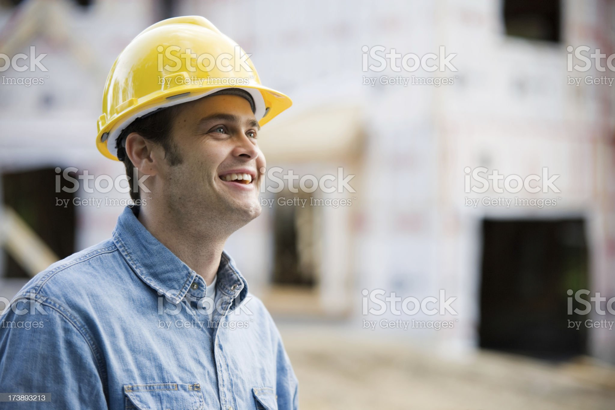 Construction Man Wearing Hard Hat at Job Site royalty-free stock photo