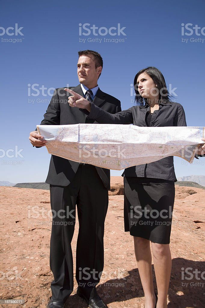 Construction manager and architect pointing at a job site stock photo