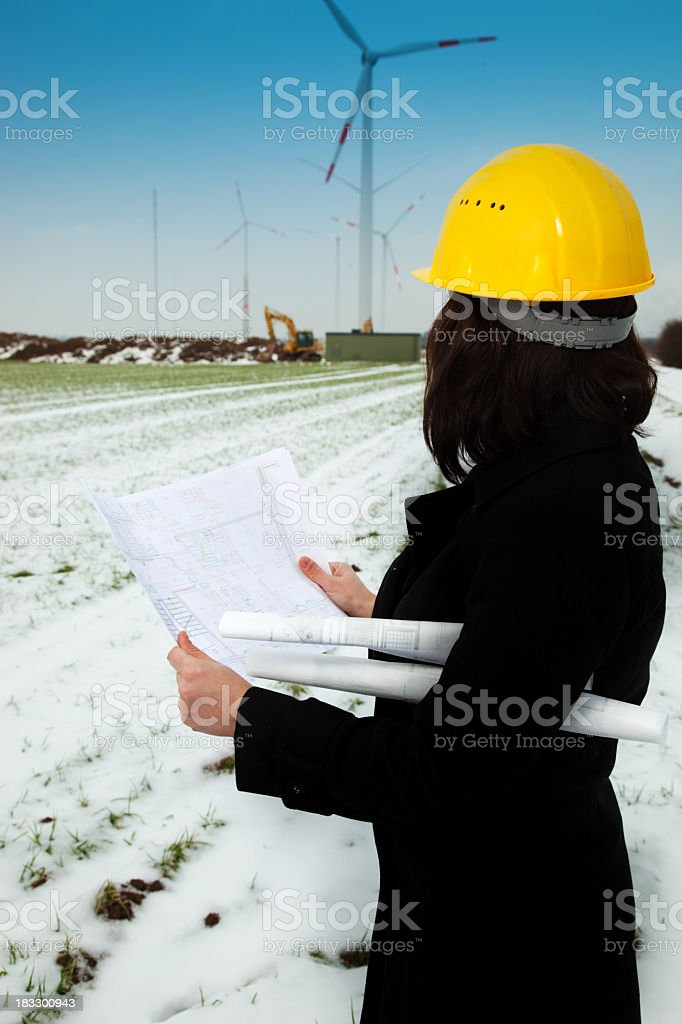 Construction manager reading plan stock photo