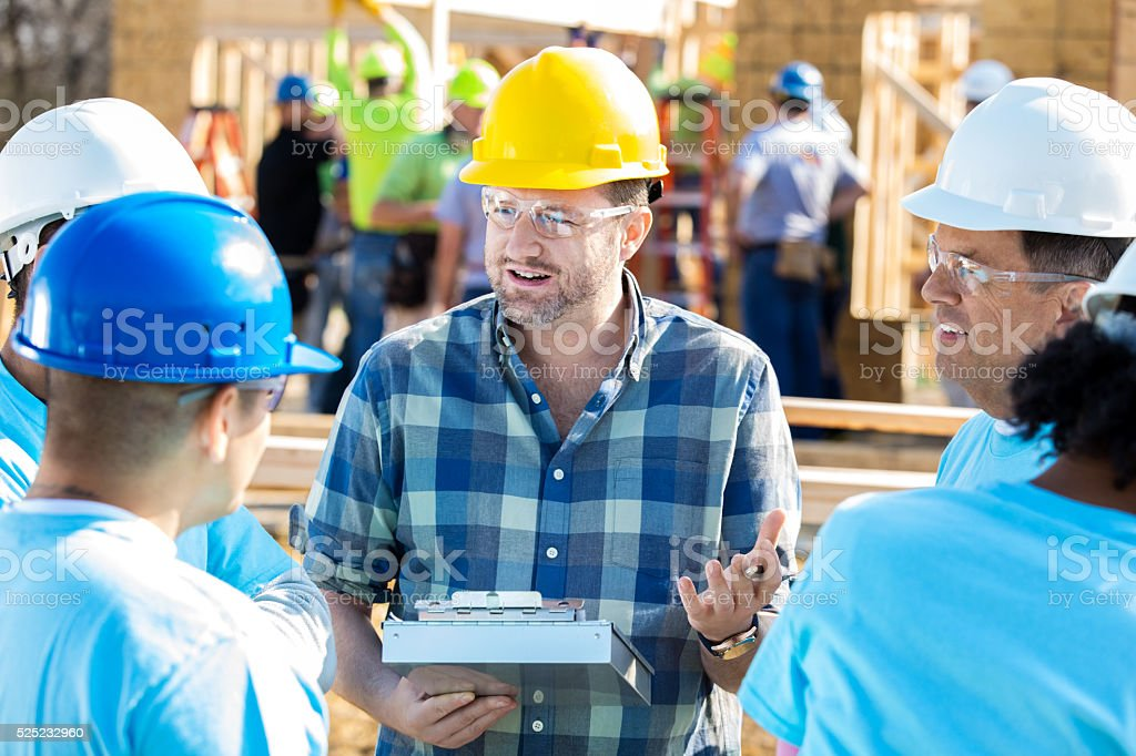Construction manager with construction workers stock photo
