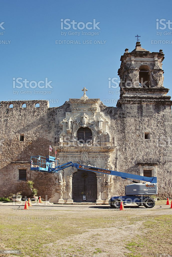 Construction Manlift in front of Historic Mission San Jose stock photo