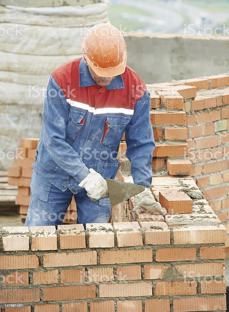 construction mason worker bricklayer royalty-free stock photo