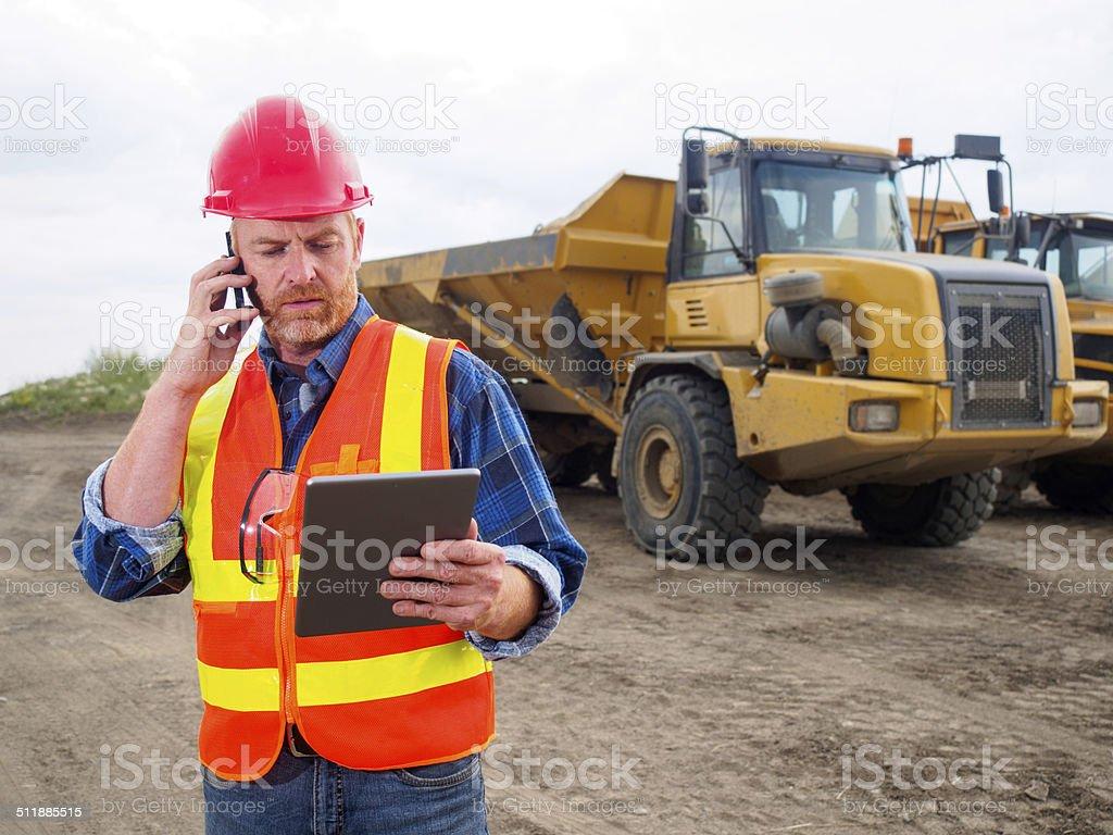 Construction Multitasking stock photo