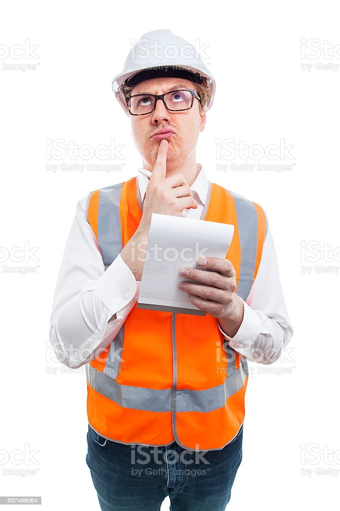 Construction Nerd thinking about what to write stock photo