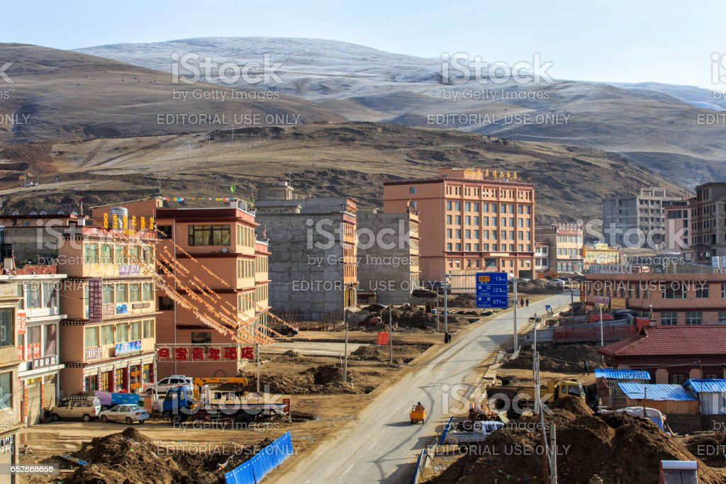 LITANG and GANZI, CHINA - MAY 02, 2016 : Construction new city at china southwes, Tibet under snow mountain, Sichuan, China stock photo