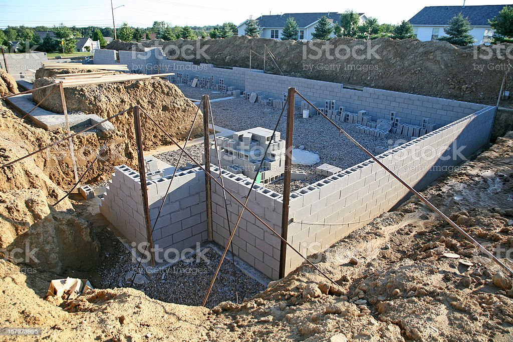 Construction of a basement wall before backfill stock photo