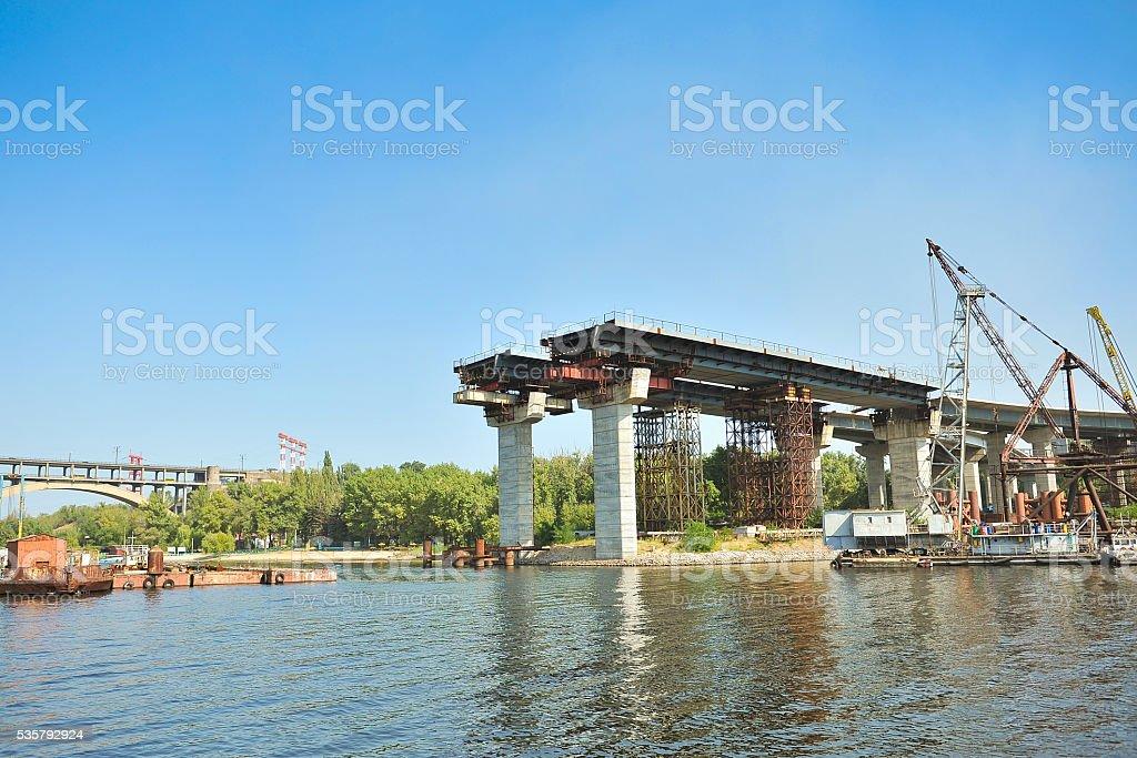 construction of a bridge across the river stock photo