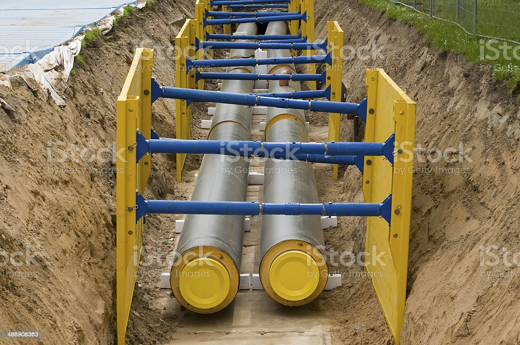Construction of a manhole for district heating pipes stock photo