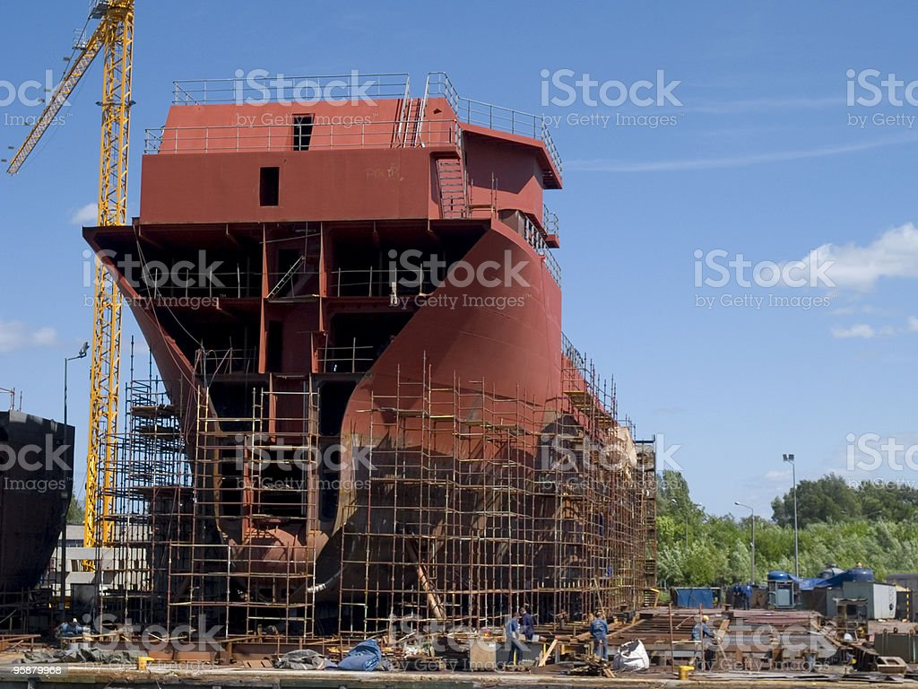Construction of a new red building on a nice, sunny day stock photo