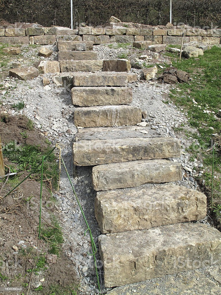 Construction of a new stone staircase in the Garden stock photo