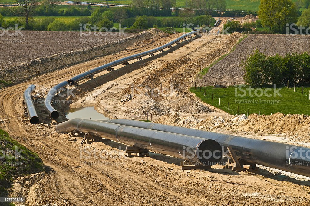 Construction of a pipeline through country fields stock photo
