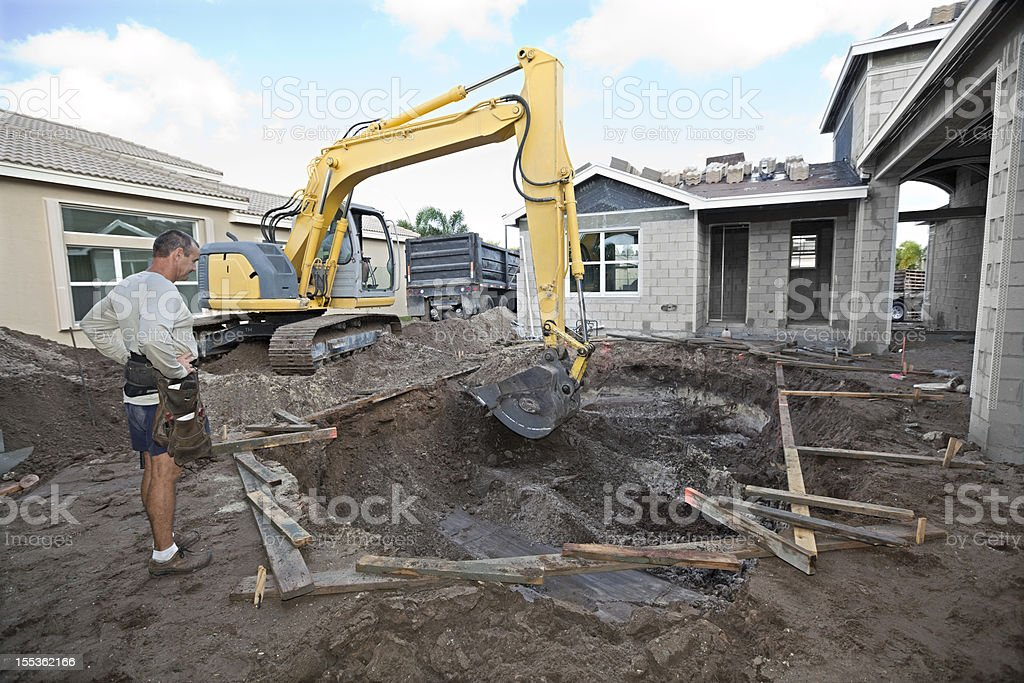 Construction of an in-ground cement swimming pool royalty-free stock photo