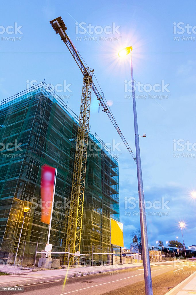 Construction of buildings with crane stock photo