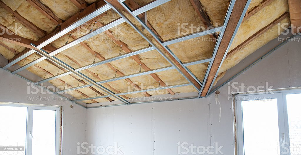 Construction of ceiling insulation stock photo