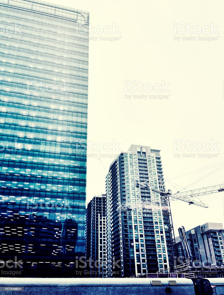 Construction of high rise condominiums in urban city stock photo